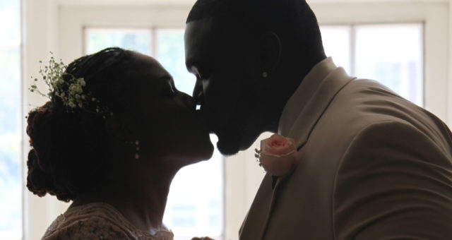 This bride and groom shared a silhouetted kiss on their wedding day | King's Daughters Inn in Durham, NC