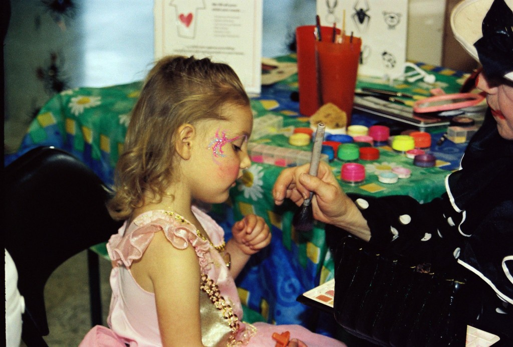 Glitter sparkles fit for a princess at this Southern Marin Mothers' Club Halloween party.