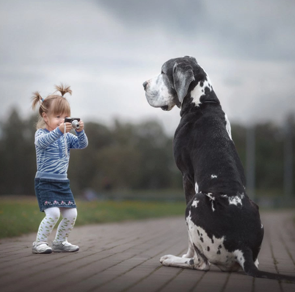 "Photo by Andy Seliverstoff in his book ""Little Kids and Their Big Dogs"""