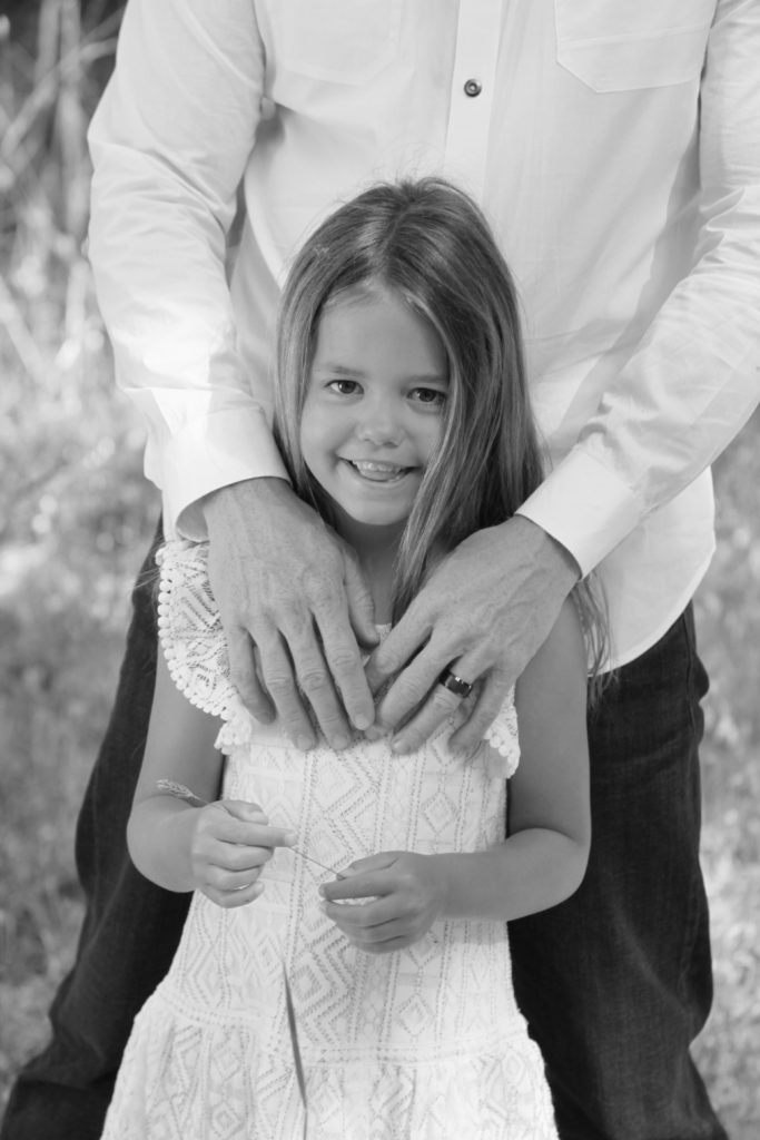 Daughters and daddies have a special place together and capturing them in black and white portraits is no different.