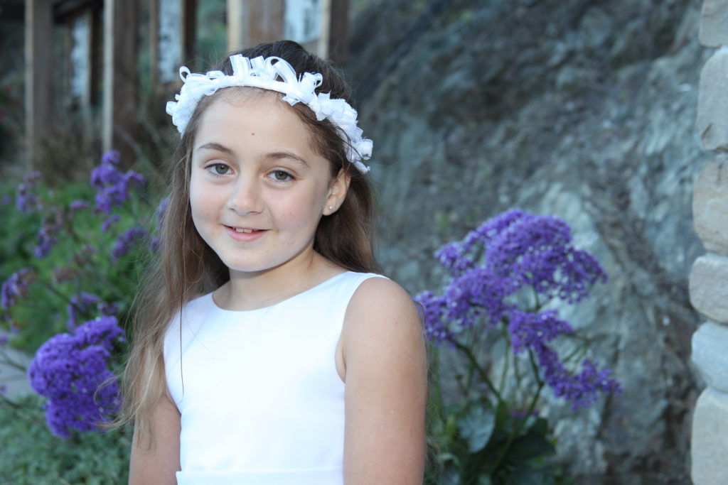 Barbara Bell Photography photographs a girl on her First Communion day. This means that she gets to dress up and feel as special as the day itself.