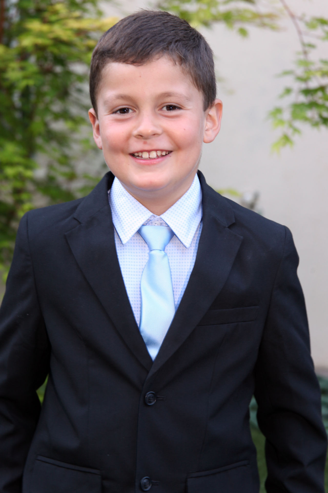 A boy's First Communion portrait at Barbara Bell Photography allows the young gentleman to have his own special portrait session for this special day.